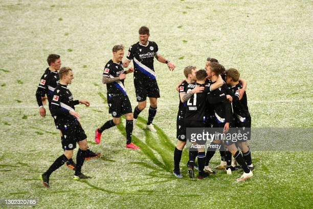 Michel Vlap of Arminia Bielefeld celebrates with teammates after scoring their team's first goal during the Bundesliga match between FC Bayern...