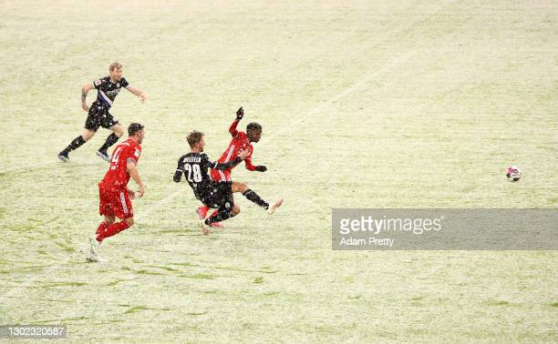 Michel Vlap of Arminia Bielefeld scores their team's first goal during the Bundesliga match between FC Bayern Muenchen and DSC Arminia Bielefeld at...