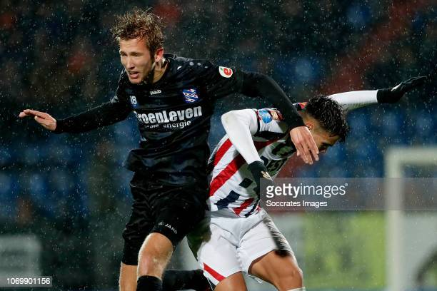 Michel Vlap of SC Heerenveen, Atakan Akkaynak of Willem II during the Dutch Eredivisie match between Willem II v SC Heerenveen at the Koning Willem...