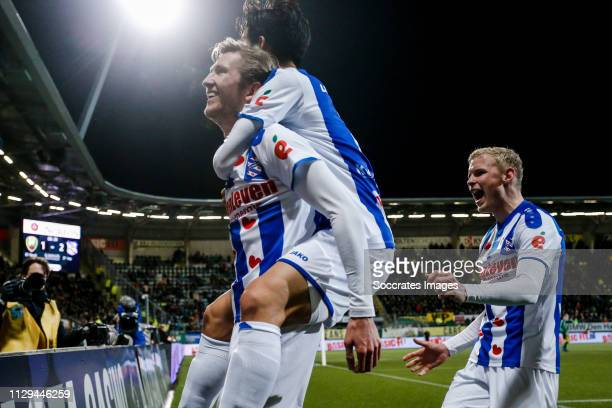 Michel Vlap of SC Heerenveen celebrate his goal the 12 with Mitchell van Bergen of SC Heerenveen Lucas Woudenberg of SC Heerenveen during the Dutch...