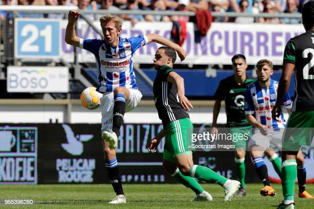 Michel Vlap of SC Heerenveen Sofyan Amrabat of Feyenoord during the Dutch Eredivisie match between SC Heerenveen v Feyenoord at the Abe Lenstra...