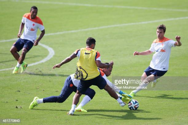 Michel Vorm and Memphis Depay compete for the ball during the Netherlands training session at the 2014 FIFA World Cup Brazil held at the Estadio Jose...