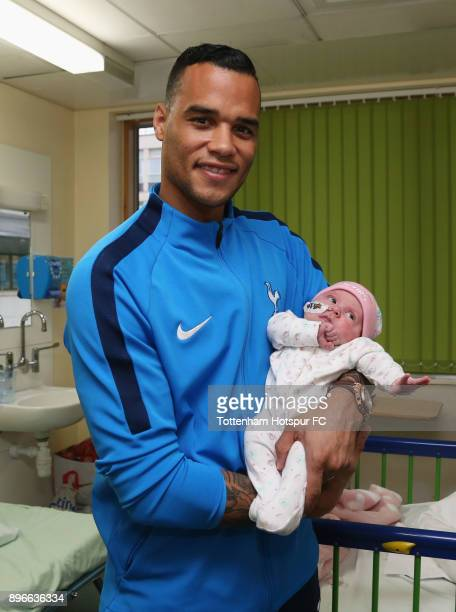 Michel Vorm holds a young patient during a Tottenham Hotspur player visit at Princess Alexandra Hospital on December 21 2017 in Harlow England