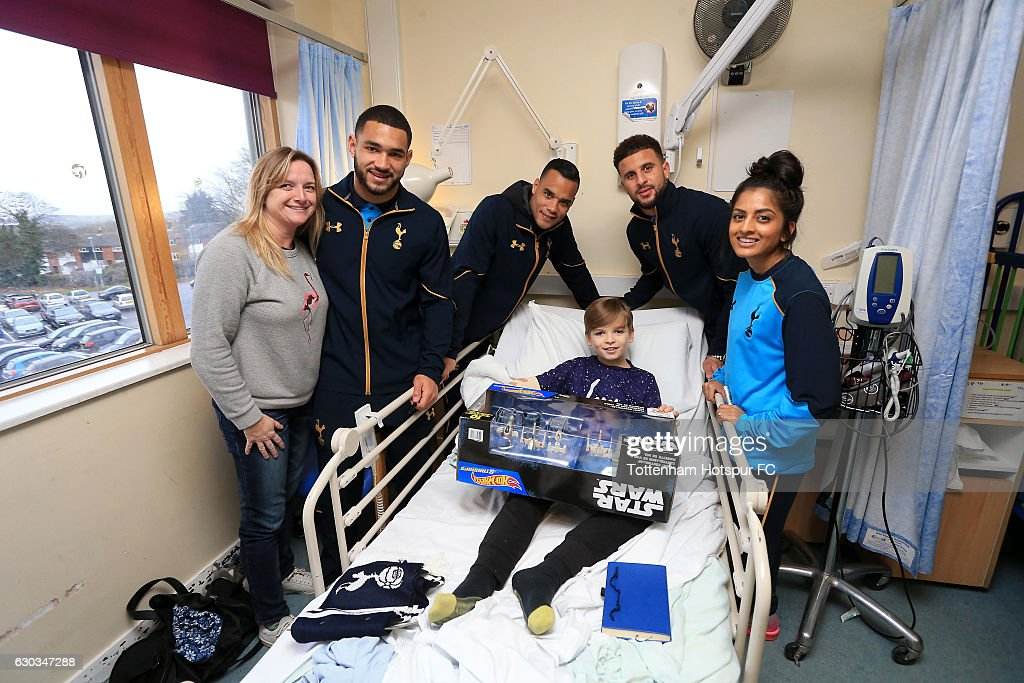 Michel Vorm, Kyle Walker, Cameron Carter-Vickers of Tottenham Hotspur and Riana Soobadoo of Tottenham Hotspur Ladies visit patients ahead of Christmas at Princess Alexandra Hospital, Harlow on December 21, 2016 in London, England.