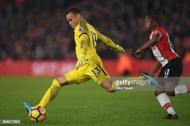 Michel Vorm of Tottenham Hotspur clears under pressure from Michael Obafemi of Southampton during the Premier League match between Southampton and...