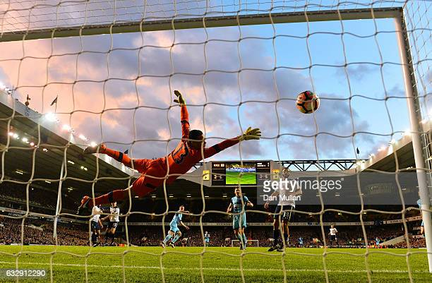 Michel Vorm of Tottenham Hotspur dives as Gary Thompson of Wycombe scores his sides hird goal during the Emirates FA Cup Fourth Round match between...