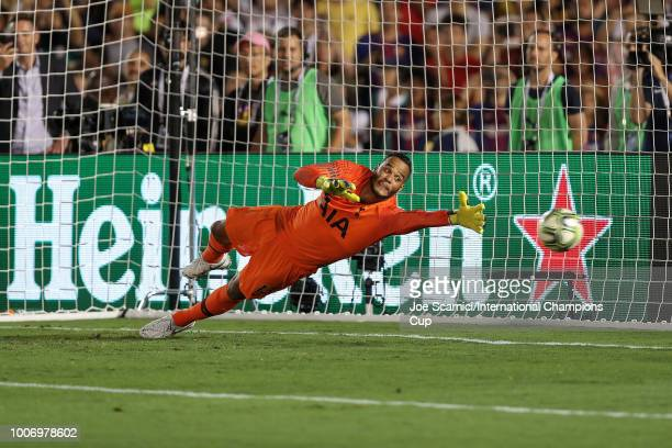 Michel Vorm of Tottenham Hotspur is unable to stop the penalty kick during an International Champions Cup match against FC Barcelona at Rose Bowl on...