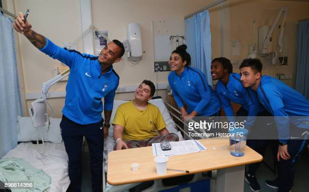 Michel Vorm Renee Hector Kazaiah Sterling and Anthony Georgiou pose for a selfie photograph as they meet a young patient during a Tottenham Hotspur...