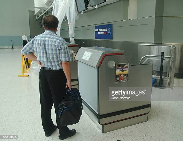 Michel Zaloum looks for information on flights at the closed Air France counter at Pearson International Airport a day after the crash of Air France...