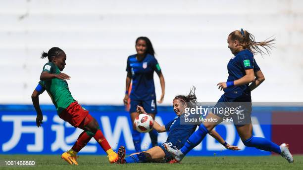 Michela Agresti and Natalia Staude of the United States struggle for the ball with Viviane Mefire of Cameroon during the FIFA U17 Women's World Cup...