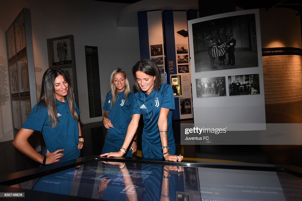 Michela Franco, Martina Rosucci and Barbara Bonansea of Juventus Women look on during a visit to the Club's Museum on August 12, 2017 in Turin, Italy.