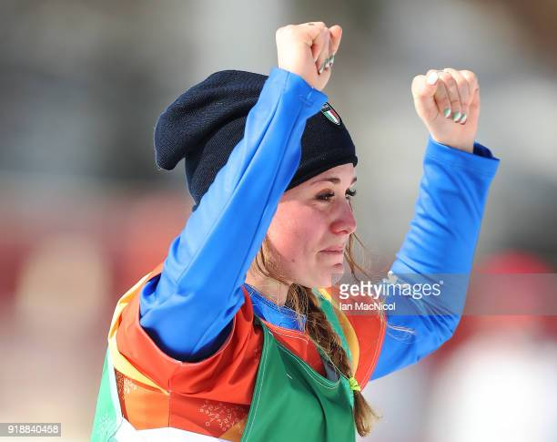 Michela Moioli of Italy stands on the podium after winning the Big Final of the Women's Snowboard Cross at Phoenix Snow Park on February 16 2018 in...