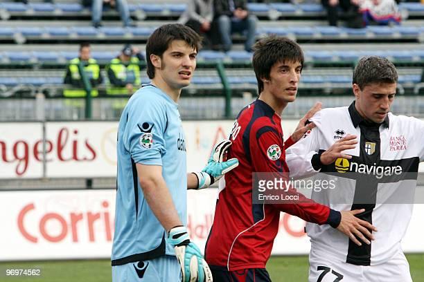 Michele Agazzi and Lorenzo Ariaudo of Cagliari and Crespo of Parma during the Serie A match between Cagliari Calcio and Parma FC at Stadio Sant'Elia...