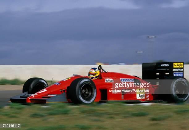 Michele Alboreto of Italy enroute to a fifteenth place finish driving a Ferrari F1/87 with a Ferrari 033E 15 V6t engine for Scuderia Ferrari SpA...