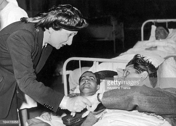 Michele AURIOL, wife of President Vincent AURIOL, visiting wounded men at the military hospital of the Invalides, in Paris on January 13, 1948.