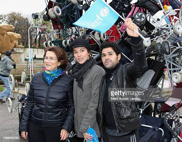 Michele Barzach and Melissa Theuriau and Jamel Debbouze poses for the Operation empty strollers for Unicef at trocadero on November 18 2012 in Paris...