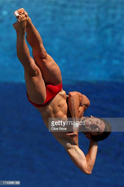 Michele Benedetti of Italy competes in the Men's 3m Springboard Diving preliminary round on day six of the 15th FINA World Championships at Piscina...