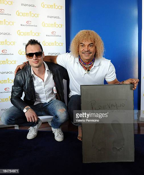 Michele Caliendo and Carlos Valderrama pose for photographers ahead of their visit to the Champions Promenade at Grimaldi Forum on October 16 2013 in...