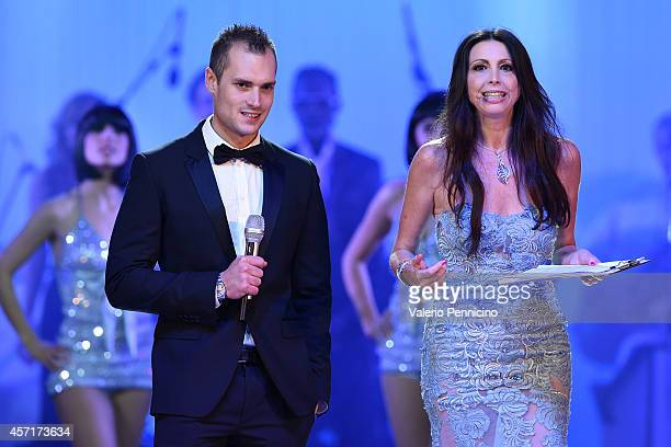 Michele Caliendo and Lorena Baricalla attend during the Golden Foot Award 2014 ceremony at Sporting Club on October 13 2014 in MonteCarlo Monaco