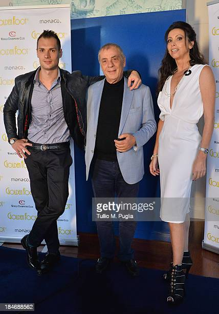Michele Caliendo Antonio Caliendo and Lorena Baricalla pose for photographers at MonteCarlo Bay prior to the 2013 Golden Foot Award on October 15...