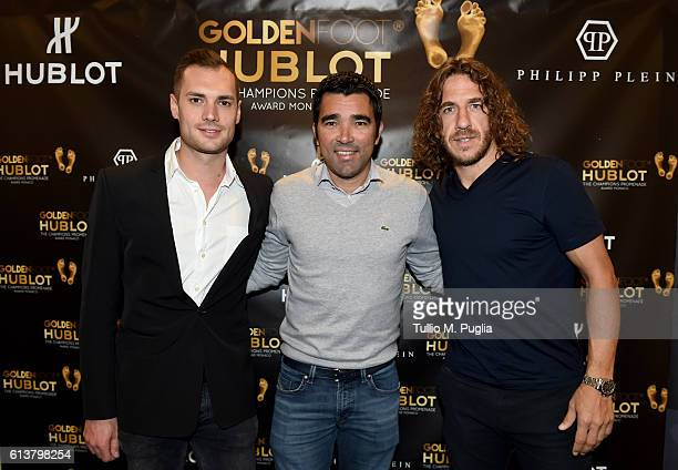 Michele Caliendo Deco and Carles Puyol pose during the Golden Foot 2016 Award Ceremony day one at Fairmont Hotel on October 10 2016 in Monaco Monaco