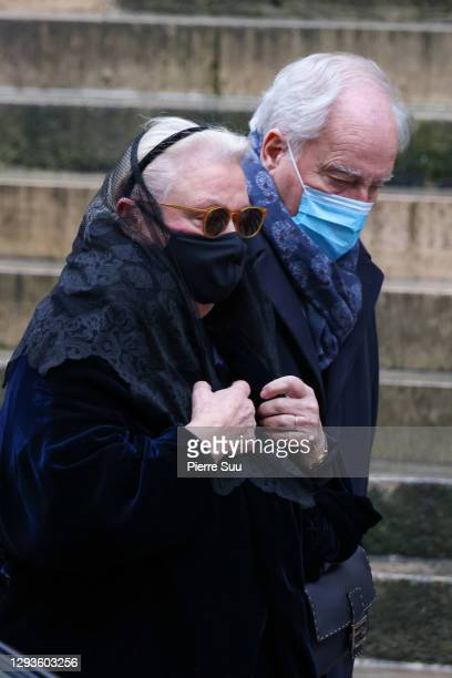 Michele Cambon-Brasseur and a guest attend Claude Brasseur's funeral at Saint Roch Church on December 29, 2020 in Paris, France.
