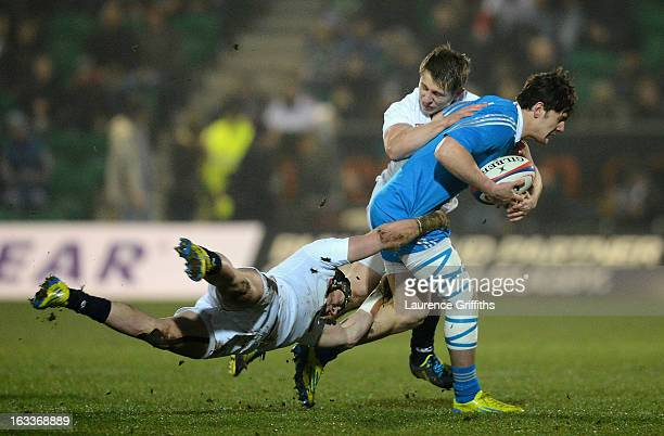Michele Campagnaro is tackled by Jack Nowell of England during the International match between England U20 and Italy U20 at Franklin's Gardens on...