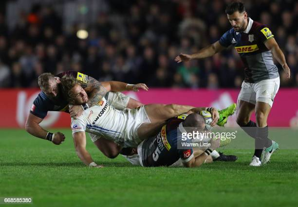 Michele Campagnaro of Exeter Chiefs is tackled off the ball by Joe Marler of Harlequins during the Aviva Premiership match between Harlequins and...