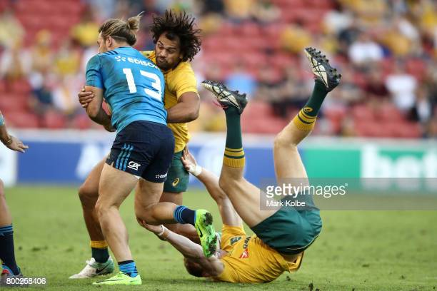 Michele Campagnaro of Italy is tackled by Karmichael Hunt and Dane HaylettPetty of the Wallabies during the International Test match between the...