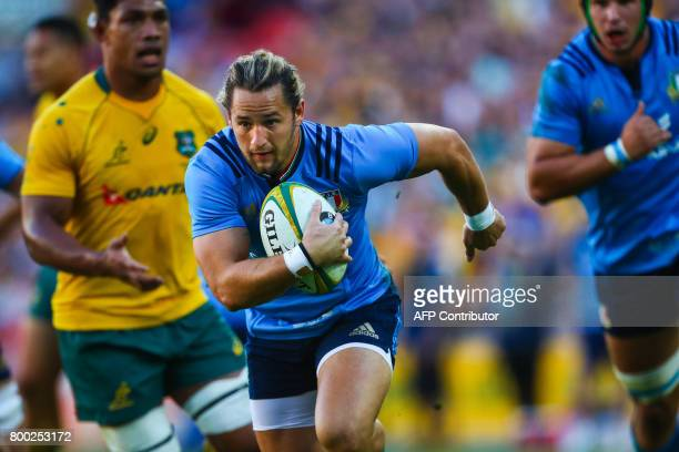 Michele Campagnaro of Italy powers past the Australian defence during the international rugby match between Australia and Italy at Suncorp Stadium in...