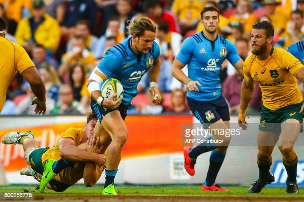 Michele Campagnaro of Italy powers past the tackle of Michael Hooper of Australian during the international rugby match between Australia and Italy...
