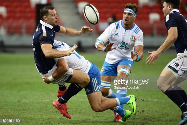 Michele Campagnaro of Italy tackles Tim Visser of Scotland during the International Test match between Italy and Scotland at Singapore Sports Stadium...