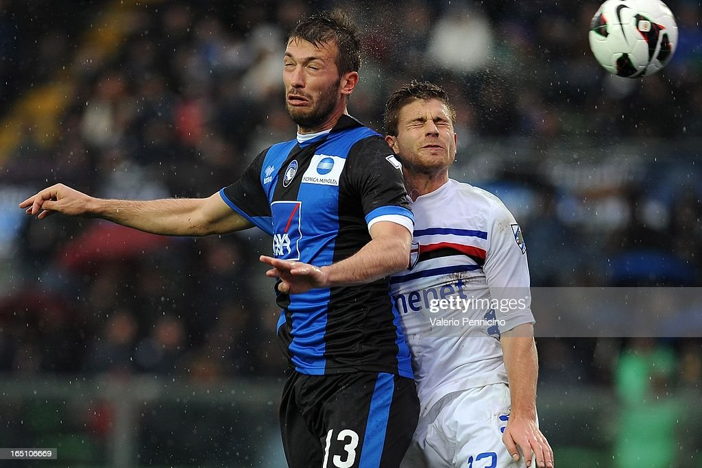 Michele Canini (L) of Atalanta BC competes for the ball in the air with Gaetano Berardi of UC Sampdoria during the Serie A match between Atalanta BC and UC Sampdoria at Stadio Atleti Azzurri d'Italia on March 30, 2013 in Bergamo, Italy.