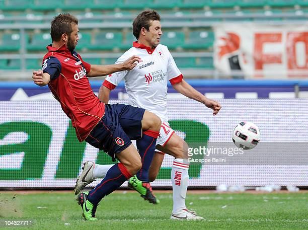 Michele Canini of Cagliari and Vitali Kutuzov of Bari compete for the ball during the Serie A match between Bari and Cagliari at Stadio San Nicola on...