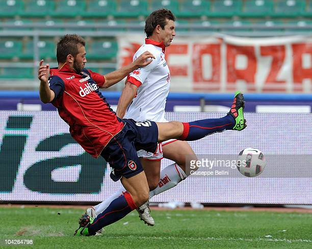 Michele Canini of Cagliari and Vitali Kutuzov of Bari in action during the Serie A match between Bari and Cagliari at Stadio San Nicola on September...