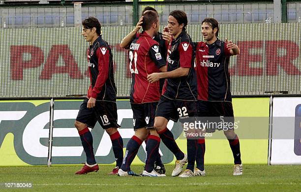 Michele Canini of Cagliari celebrates after scoring their third goal with teammates during the Serie A match between Cagliari and Lecce at Stadio...