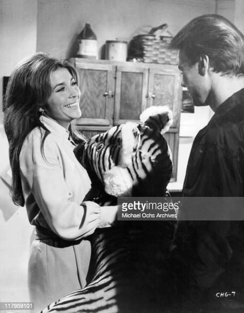 Michele Carey is delighted with the stuffed animal Kent Lane won for her in a scene from the film 'Changes' 1969