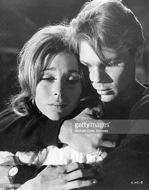 Michele Carey is embraced by Kent Lane in a scene from the film 'Changes' 1969