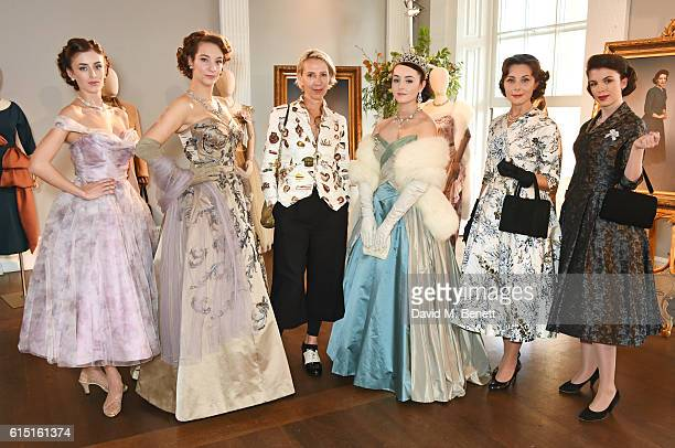 Michele Clapton poses with models at a presentation featuring costumes from new Netflix Original series 'The Crown' with designer Michele Clapton at...