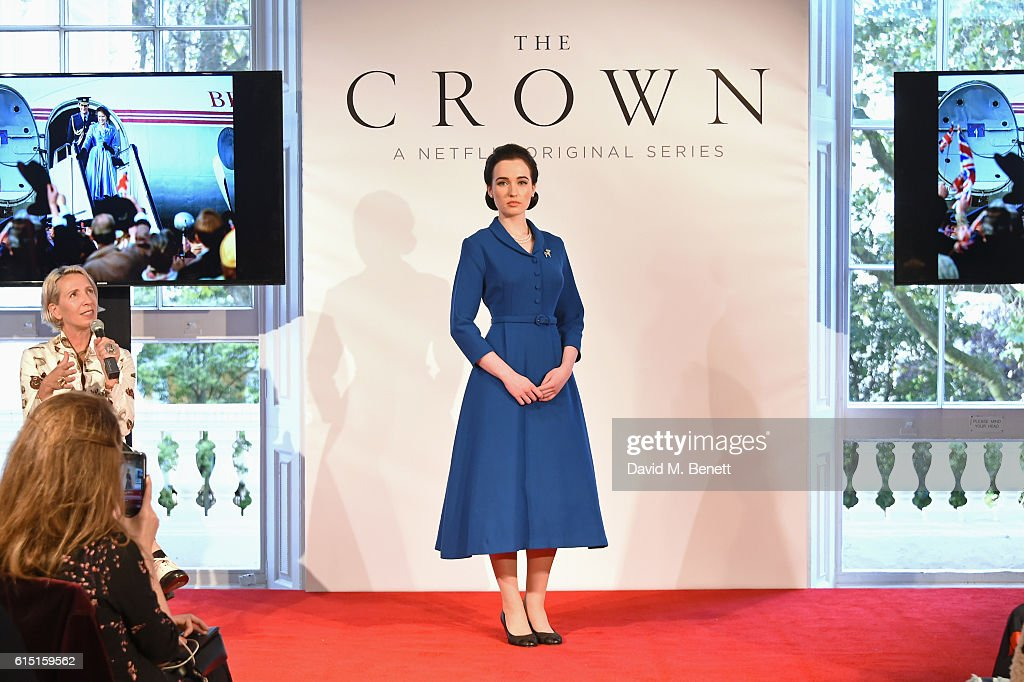 Michele Clapton (L) speaks as a model poses at a presentation featuring costumes from new Netflix Original series 'The Crown' with designer Michele Clapton at the ICA on October 17, 2016 in London, England.