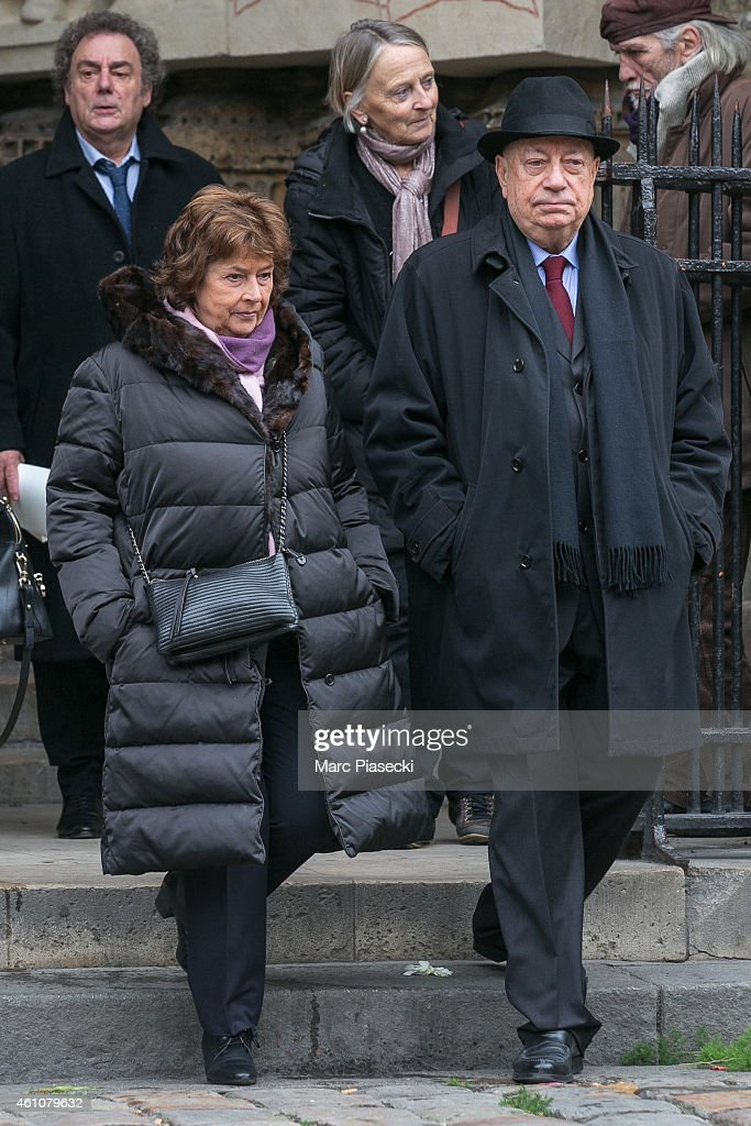 Michele Cotta and Herve Bourges leave the funeral of journalist Jacques Chancel at Saint-Germain-des-Pres church on January 6, 2015 in Paris, France.