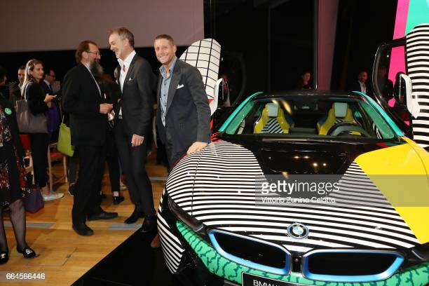 Michele De Lucchi Adrian van Hooydonk and Lapo Elkann attend Memphis event during Milan Design Week 2017 on April 4 2017 in Milan Italy