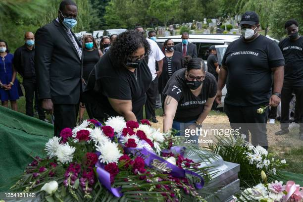 Michele FlippenColeman lies a flower on the casket of her husband Conrad Coleman Jr at his burial on July 03 2020 in Rye New York Coleman died of...
