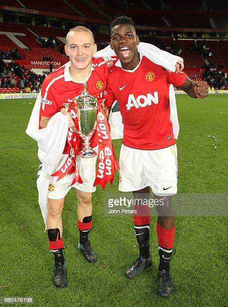 Michele Fornasier and Paul Pogba of Manchester United Academy Under18s celebrate with the FA Youth Cup trophy after the FA Youth Cup Final Second Leg...