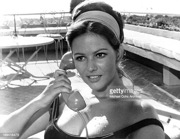 Michele Girardon on the phone outside in a scene from the film 'The Magnificent Cuckold' 1964