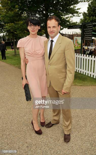 Michele Hicks and Johnny Lee Miller attend Ladies Day at the Glorious Goodwood Festival at Goodwood on July 29 2010 in Chichester England