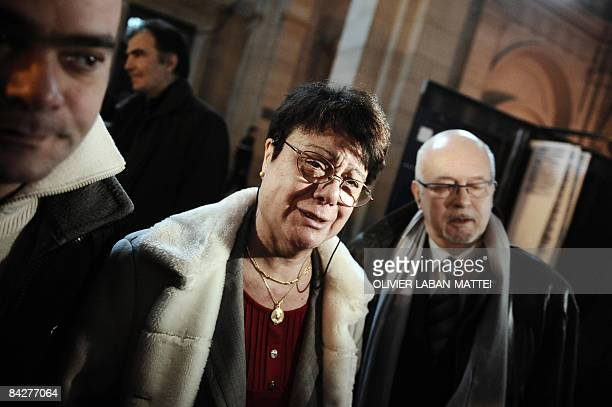 Michele Jolivet who had a children infected with human variant mad cow disease sobs at the courthouse in Paris on January 14 after a French court...