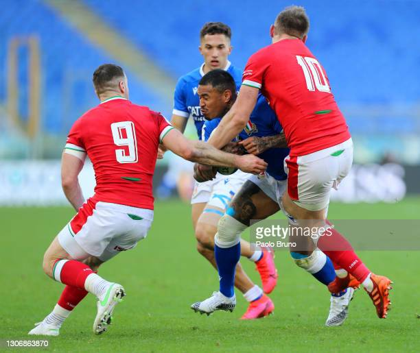 Michele Lamaro of Italy is tackled by Gareth Davies and Dan Biggar of Wales during the Guinness Six Nations match between Italy and Wales at Stadio...