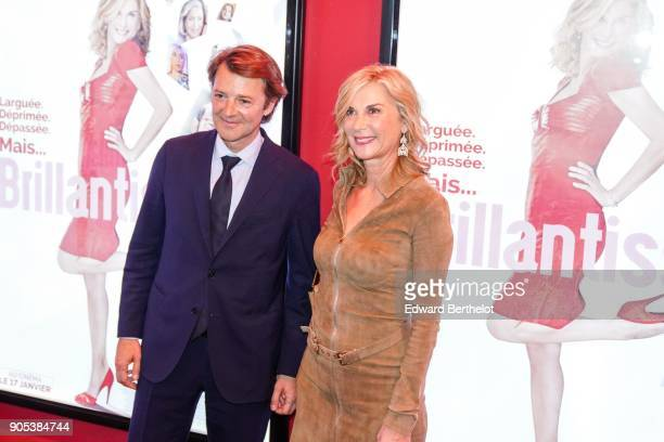 """Michele Laroque and Francois Baroin are seen, during the """"Brillantissime"""" Photocall, at Publicis Champs Elysees on January 15, 2018 in Paris, France."""