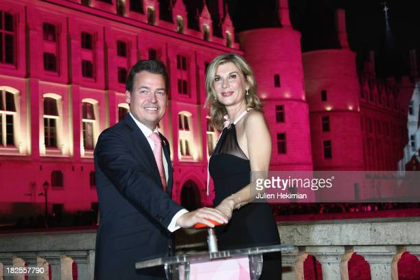 Michele Laroque and Henk Van Der Mark attend the 'Octobre Rose' party hosted by Estee Lauder at La Conciergerie on September 30 2013 in Paris France